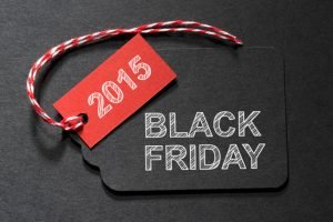 Black Friday 2015 text on a black tag with a red and white twine